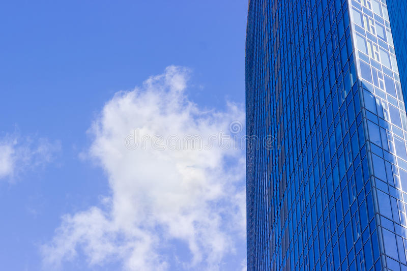 Fragment of the office building against the sky with cloud. Fragment of the large modern multistory office building against the background of sky with cloud stock photography