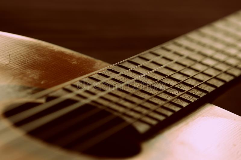 Fragment of an old acoustic guitar. Close-up royalty free stock images