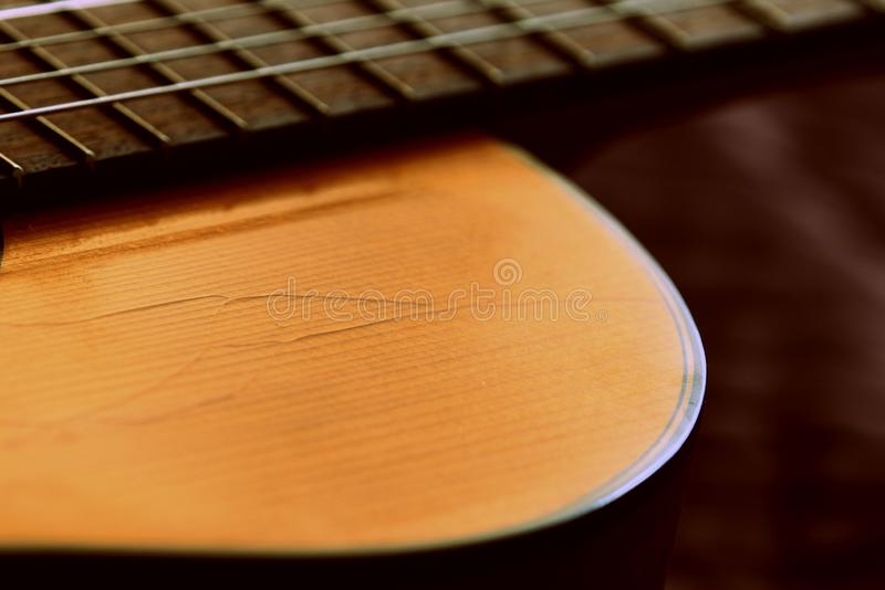 Fragment of an old acoustic guitar. Close-up royalty free stock photo