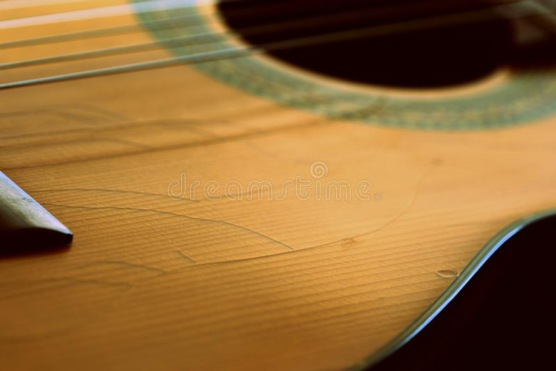 Fragment of an old acoustic guitar. Close-up royalty free stock image