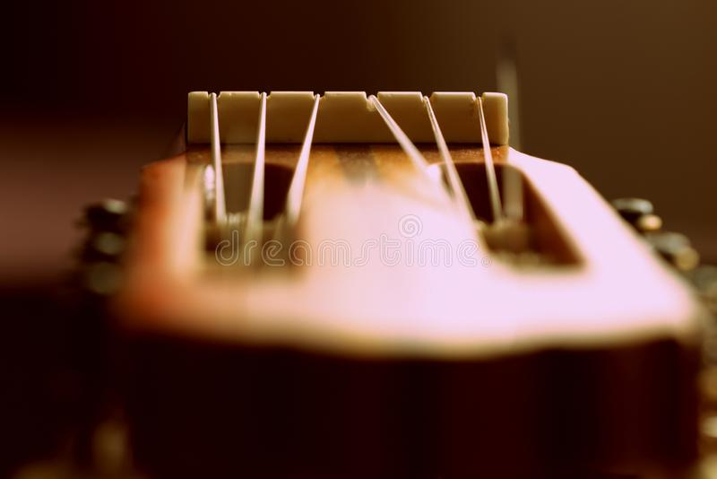 Fragment of an old acoustic guitar. Close-up stock image