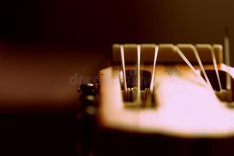 Fragment of an old acoustic guitar. Close-up royalty free stock photography