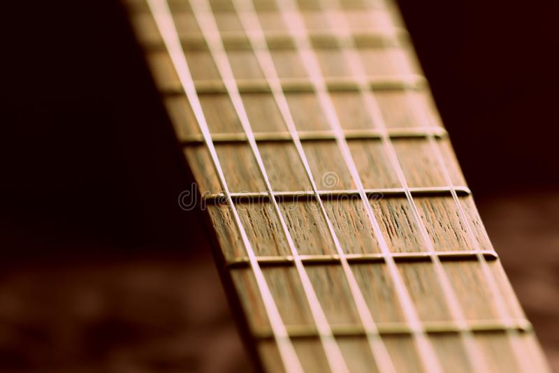 Fragment of an old acoustic guitar. Close-up royalty free stock photos
