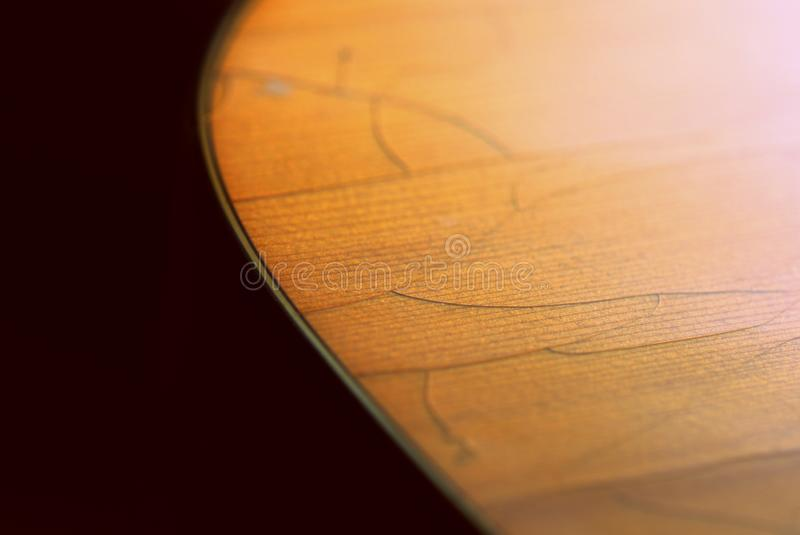 Fragment of an old acoustic guitar. Close-up stock photography