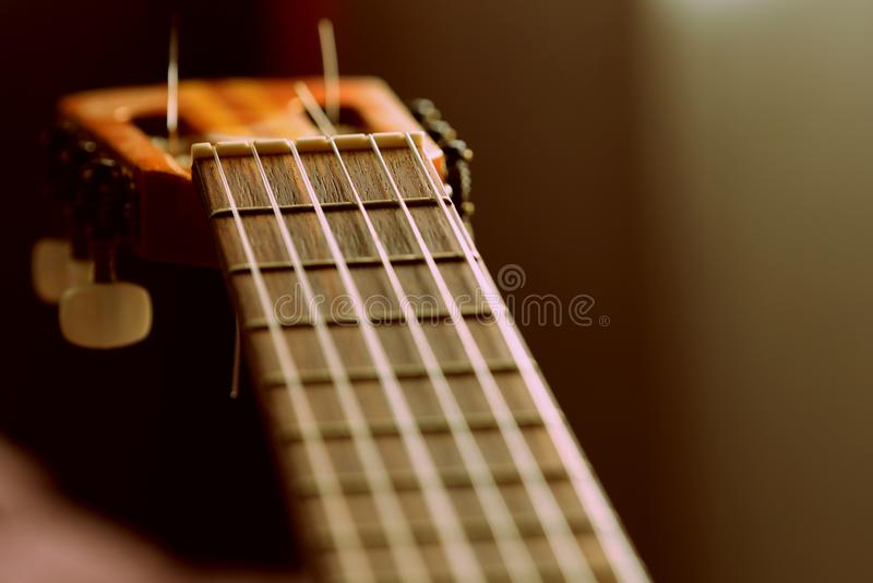 Fragment of an old acoustic guitar. Close-up stock images