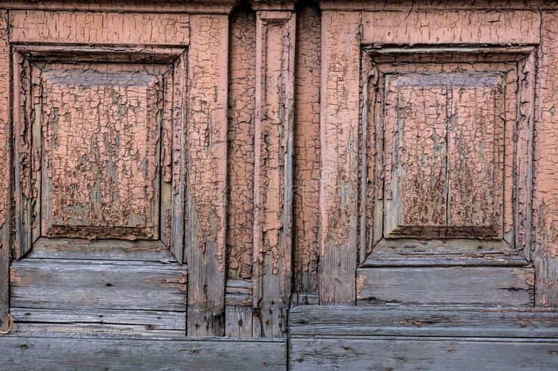 Fragment of an old brown painted door, background, aged wooden textured surface.  stock image