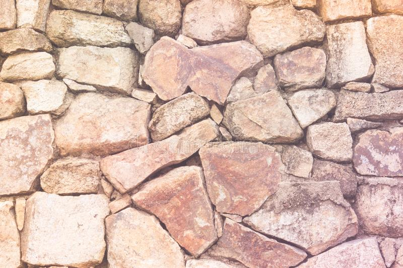 Fragment of old brown slate rock wall, natural texture. Fragment of old brown slate rock wall, natural old rock texture royalty free stock photography