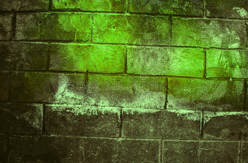 Fragment of old dirty brick wall with peeling plaster texture white grey brown black green blue lime yellow orange maroon violet p. Ink turquoise, stone surface stock photos