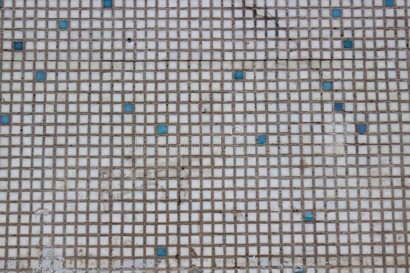 Fragment of an old dirty wall of ceramic mosaic royalty free stock photos