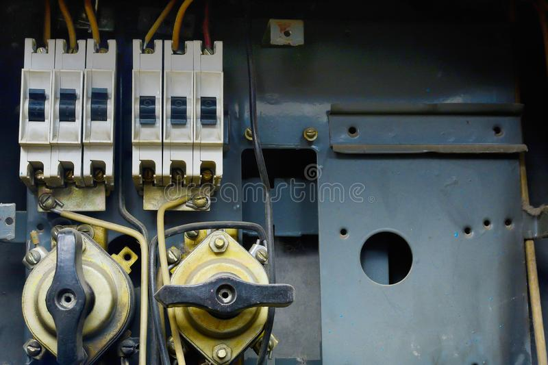 Fragment of an old electrical shield. With messy and carelessly laid wires. royalty free stock images
