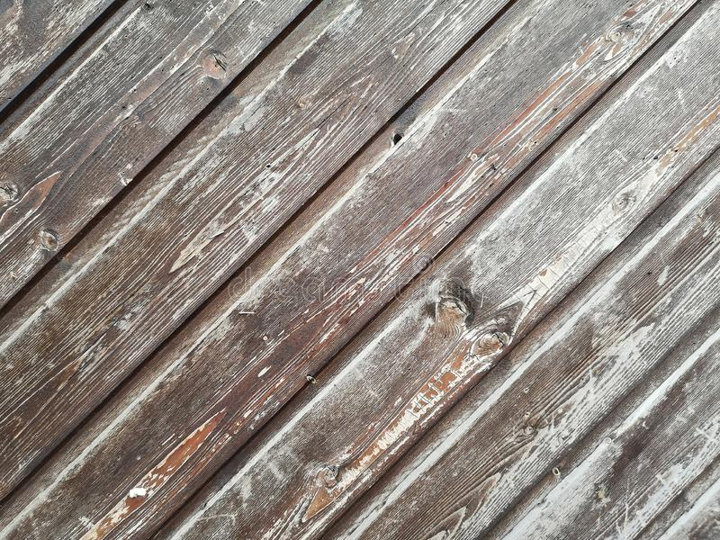 Fragment of an old historical Doors made of natural wooden boards with knots. Background. royalty free stock photography