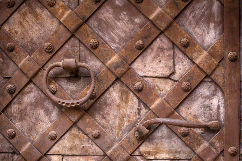 Fragment of the old iron door. Metal doors stock photography