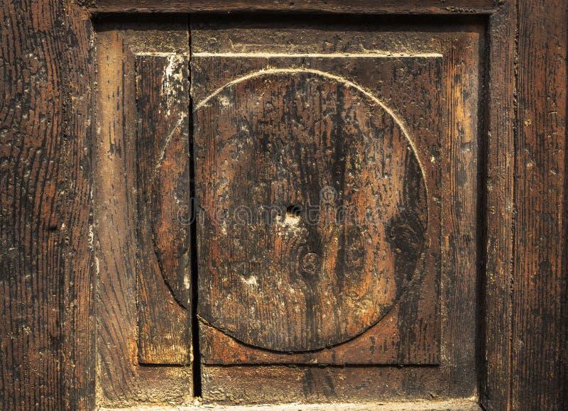 Fragment of old wooden door Brown stock photos