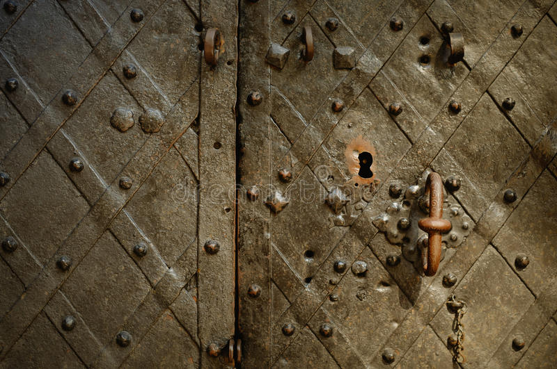 Fragment of the old wrought bronze doors. Of the palace with a handle and lock stock photo