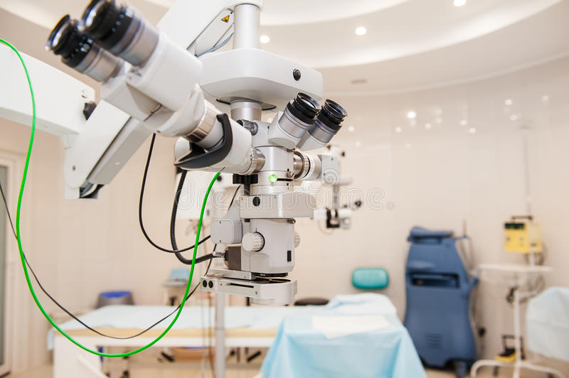 Fragment of ophthalmic laser system in eye surgery clinic. Selective focus, close up. Fragment of ophthalmic laser system in eye surgery clinic. Selective focus stock images