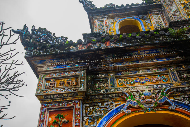 A fragment of an ornament with dragon and flowersEntrance of Citadel, Hue, Vietnam. Entrance of Citadel, Hue, Vietnam. Unesco World Heritage Site.A fragment of stock images