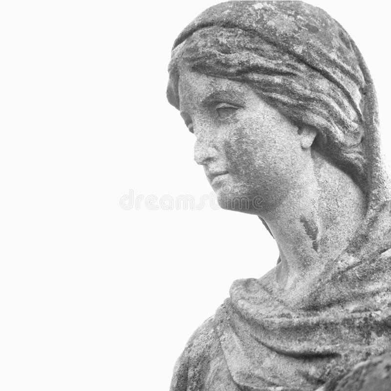 Fragment os statue of Mary Magdalene. On white background royalty free stock image