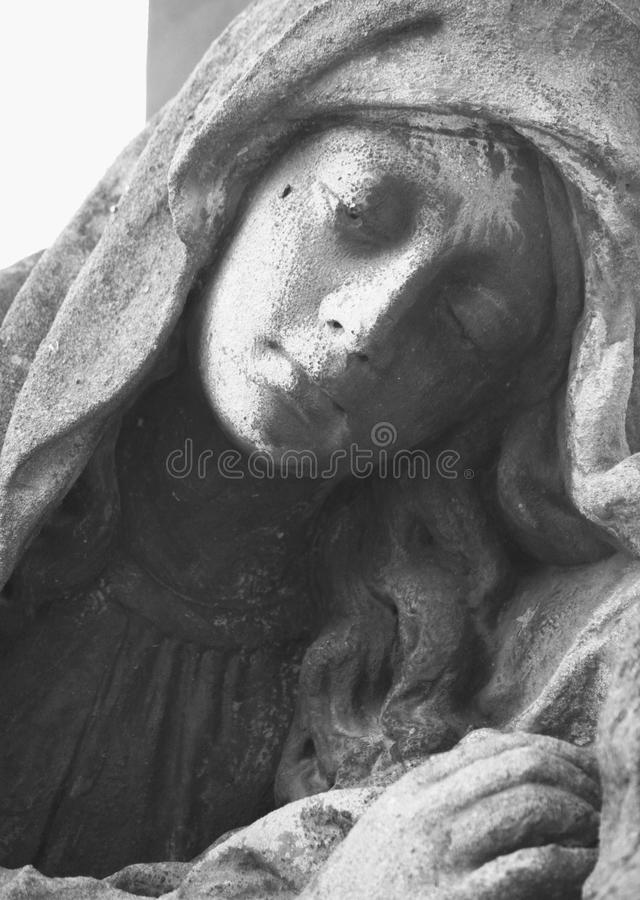 Fragment os statue of Mary Magdalene. On white background royalty free stock photography