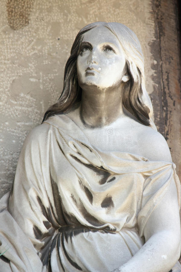 Fragment os statue of Mary Magdalene. On white background stock images