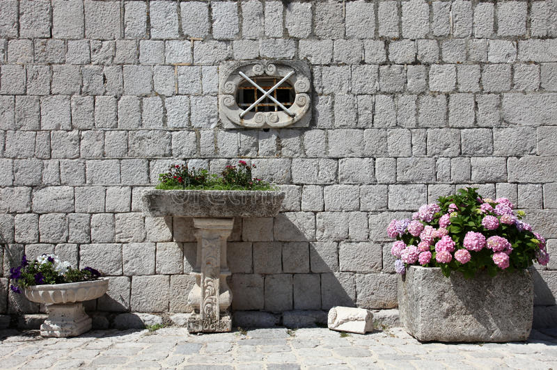 Fragment of Our Lady of the Rock church in Perast stock image