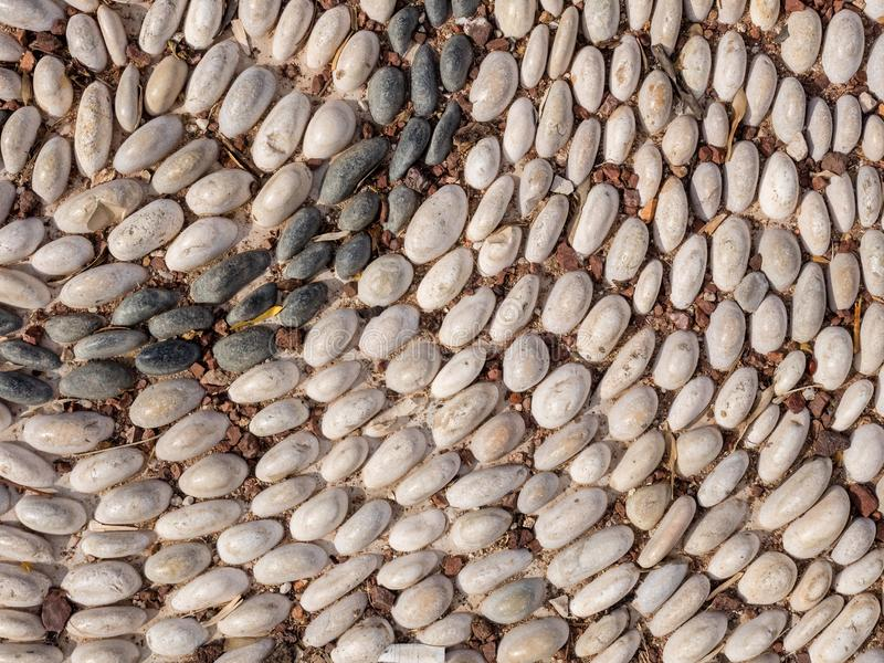 Fragment of pavement made of river round pebbles in a public park, Antalya, Turkey. Landscape design stock photos