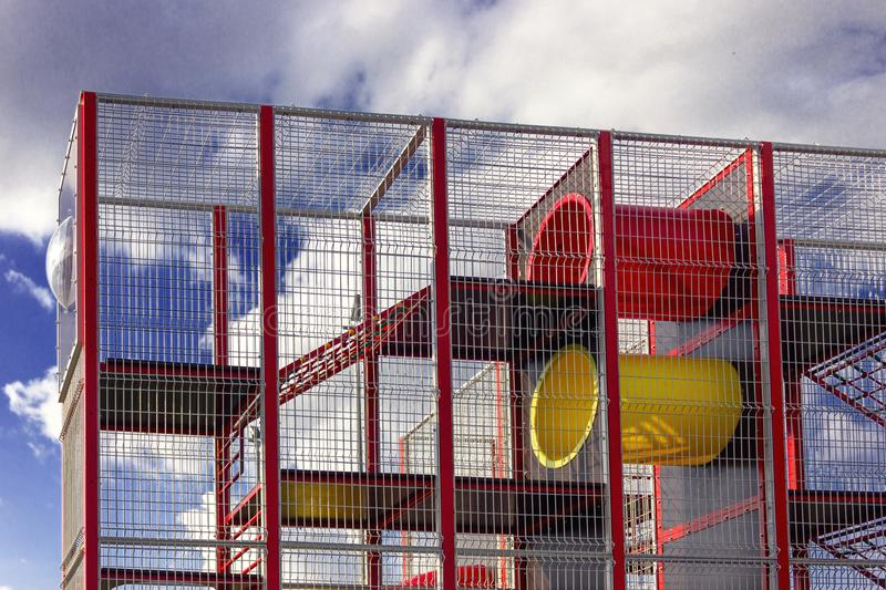 A fragment of a playground for children against the sky in a park stock photography