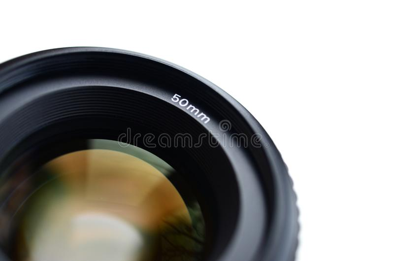 Fragment of a portrait lens for a modern SLR camera. A photograph of a wide-aperture lens with a focal length of 50mm isolated on royalty free stock image