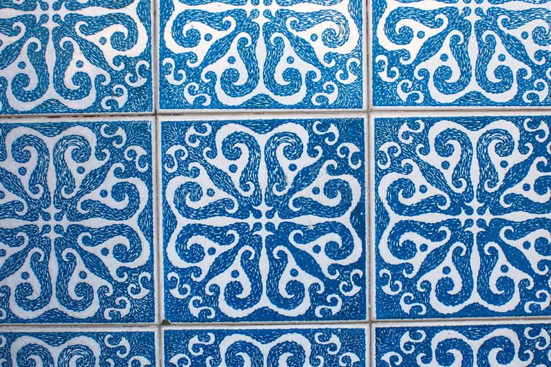Fragment of portuguese traditional tiles Azulejo with pattern in old Porto royalty free stock photos