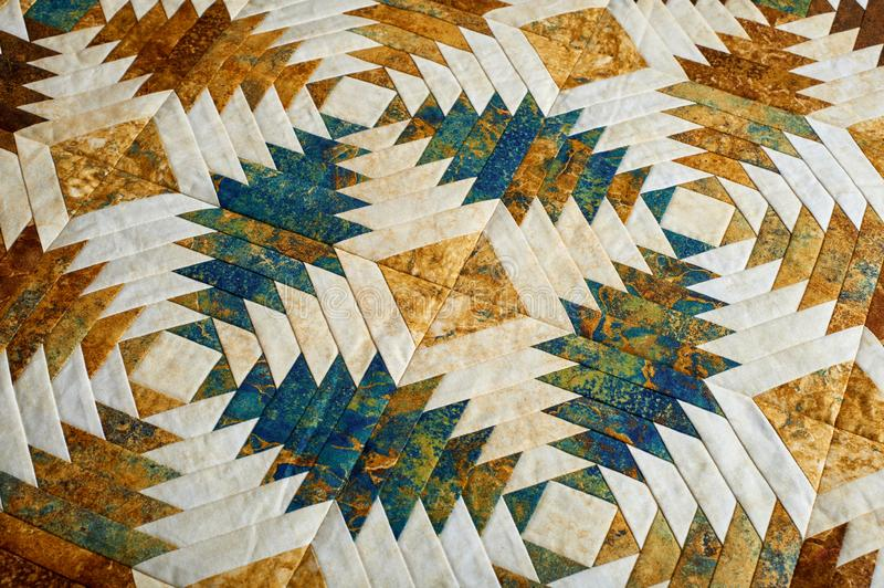 Fragment of quilt stitched from pineapple pattern blocks, traditional patchwork stock photography