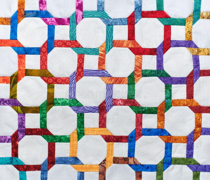 Fragment quilt top sewn by hand from geometric figures stock photos