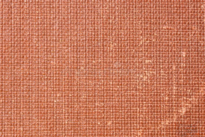 Fragment of a red textured cover of an old book. Background and backdrop. Vintage royalty free stock images