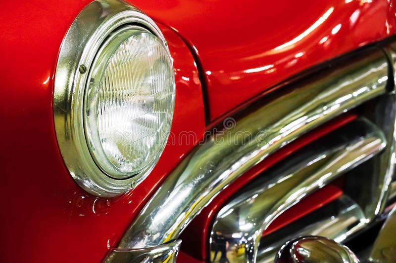 Fragment red vintage car. Fragment of beautiful shiny red vintage car stock photos