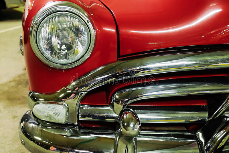 Fragment red vintage car. Fragment of beautiful shiny red vintage car royalty free stock images