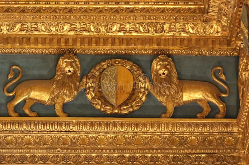 Fragment of renaissance carved ceiling in the Sala dei Gigli in Palazzo Vecchio, Florence, Tuscany, Italy. stock photo