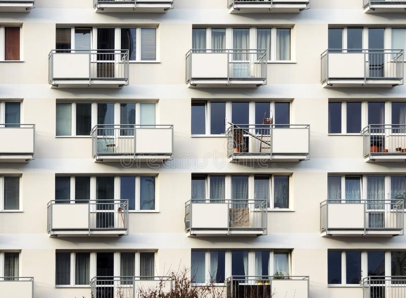 Fragment of residential block of flats. With balconies stock images
