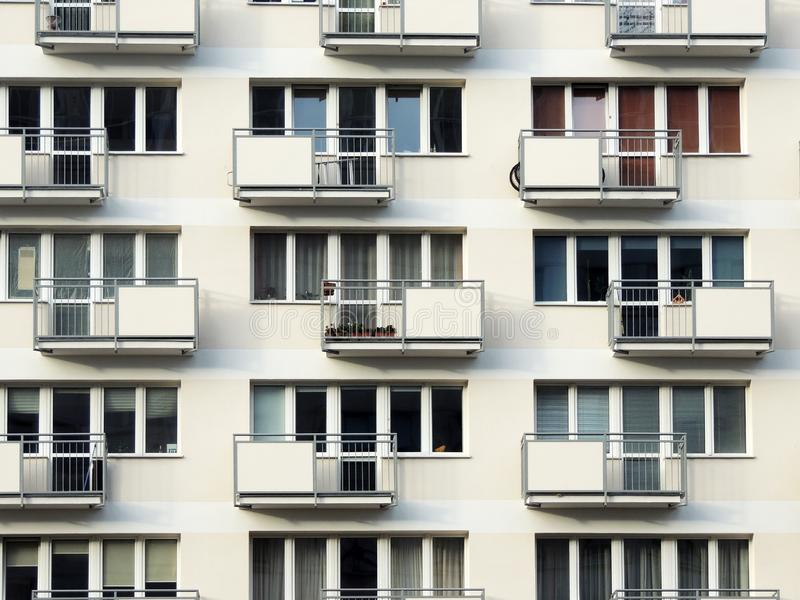 Fragment of residential block of flats. With balconies royalty free stock photo