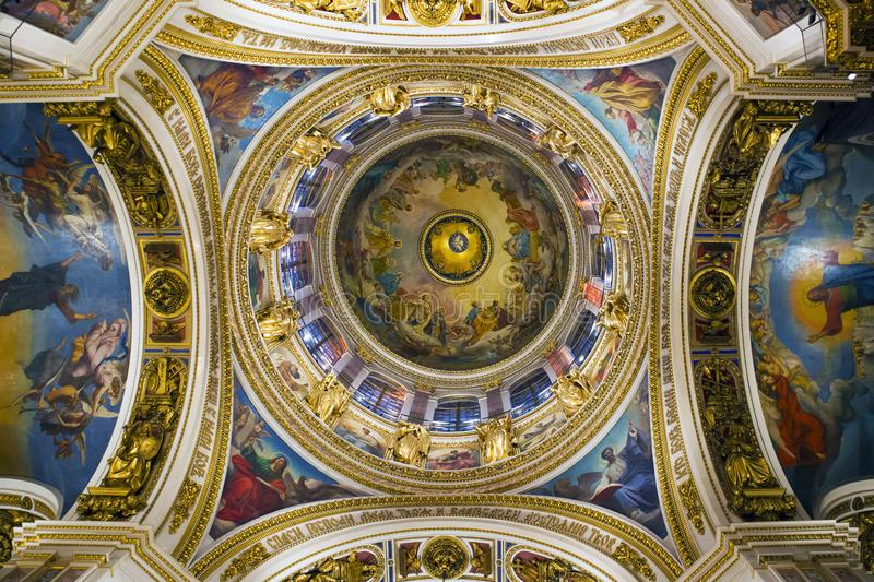 Fragment of rich decorated interior of ancient Saint Isaac`s orthodox cathedral royalty free stock photos