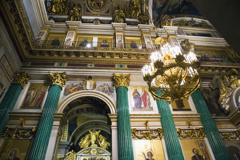 Fragment of rich decorated interior of ancient Saint Isaac`s orthodox cathedral royalty free stock photography