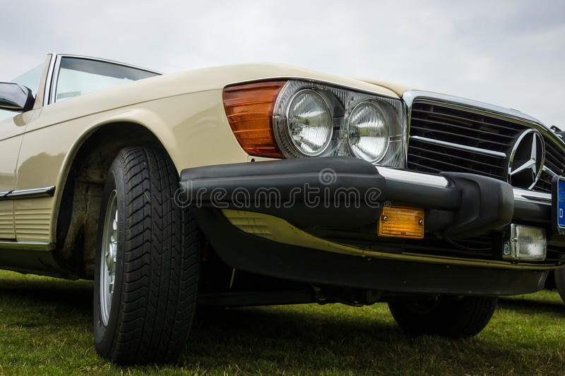 Fragment of a roadster Mercedes-Benz 450SL (R107), 1980. PAAREN IM GLIEN, GERMANY - MAY 23, 2015: Fragment of a roadster Mercedes-Benz 450SL (R107), 1980. The stock image
