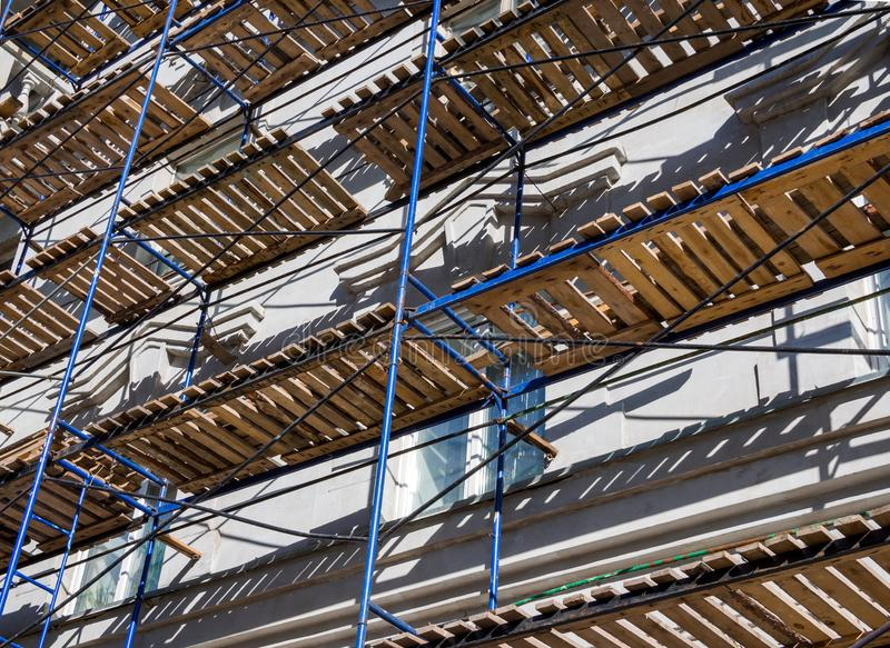 Fragment of scaffolding on the facade of the building royalty free stock photo