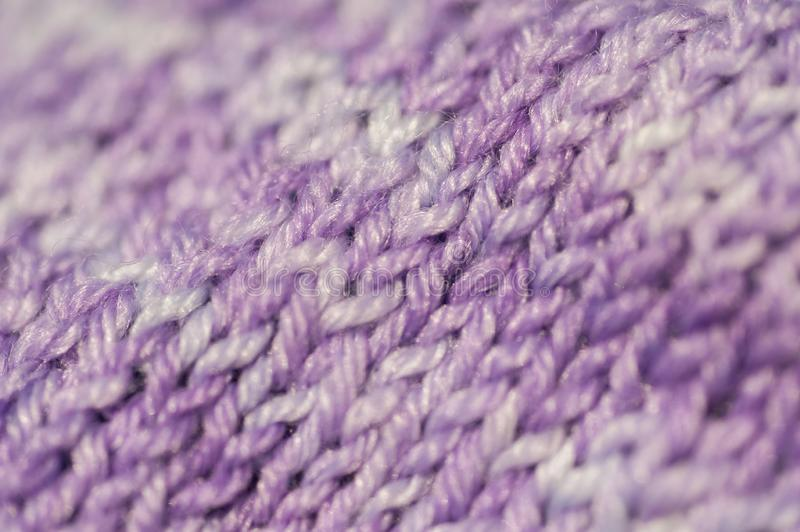 Fragment of seamless knitted patterns with range of purple colors. Realistic knitted texture for the background of the site, invitations, wallpapers stock photos