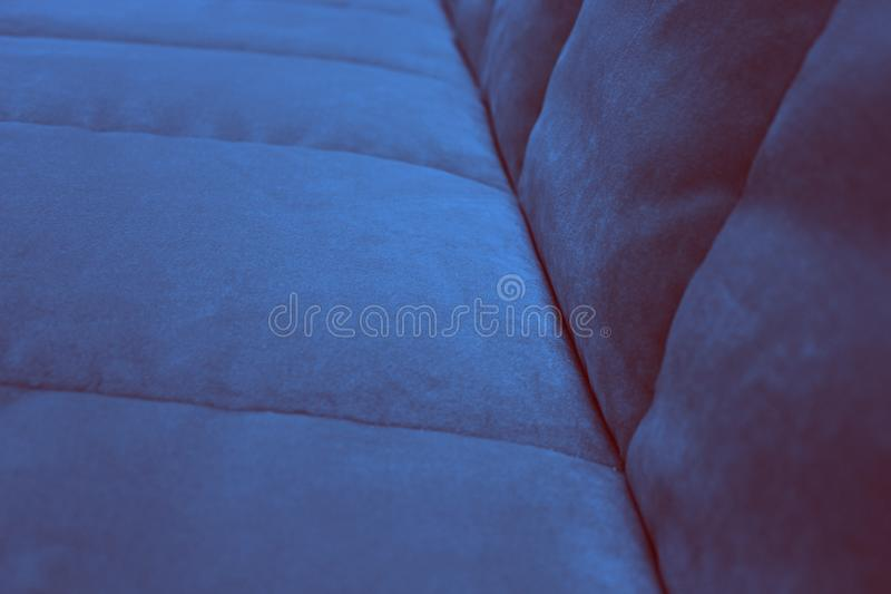 A fragment of the seat and back of the navy blue sofa. royalty free stock photos
