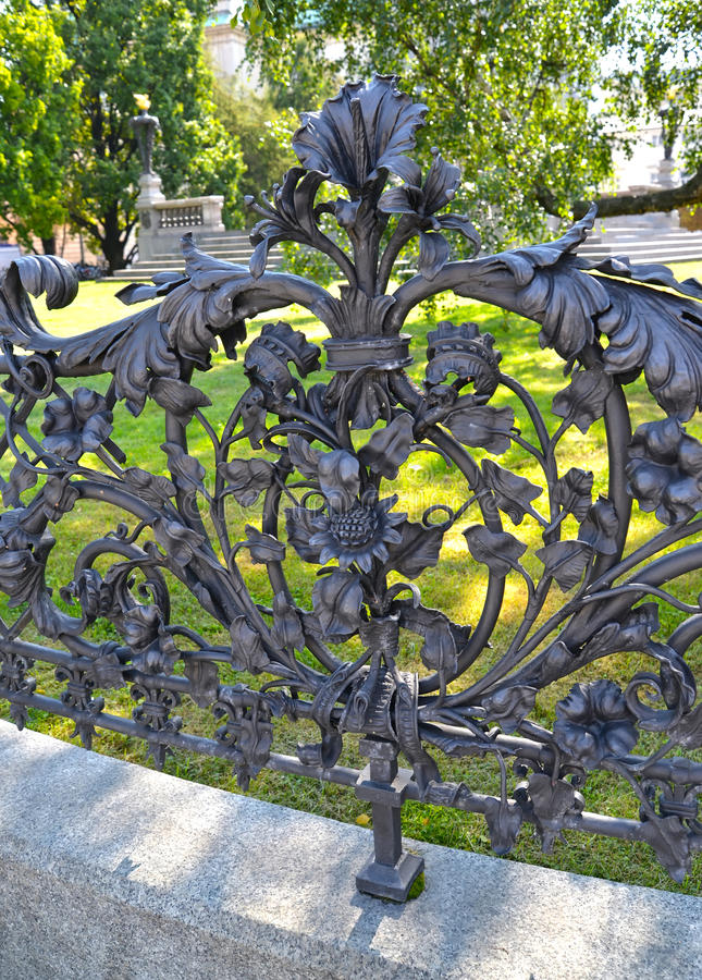 Fragment of a shod fencing around a monument to Adam Mickiewicz. Warsaw, Poland royalty free stock images