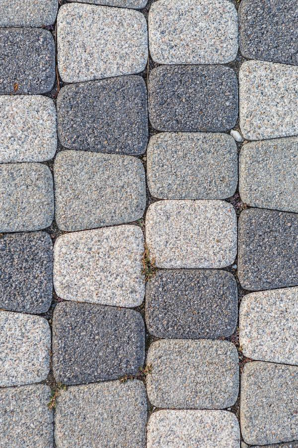 Fragment of stone pavement cobble-stones texture as a background stock photography