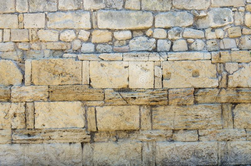 Fragment of the stone wall of the ancient city stock photos