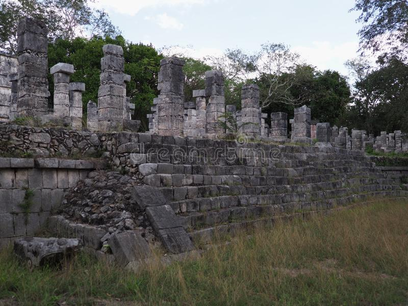 Fragment of stony platform of Temple of Warriors at Chichen Itza city in Mexico on February stock image