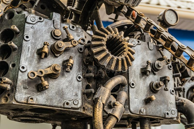 Fragment of street metal sculpture of a robot made of old cars parts and details, auto-waste. stock image