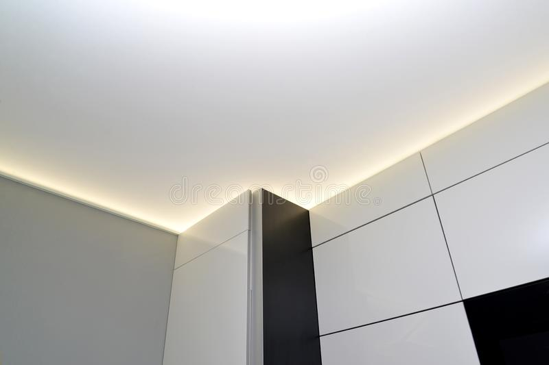 Fragment of a stretch ceiling with the hidden LED illumination stock image