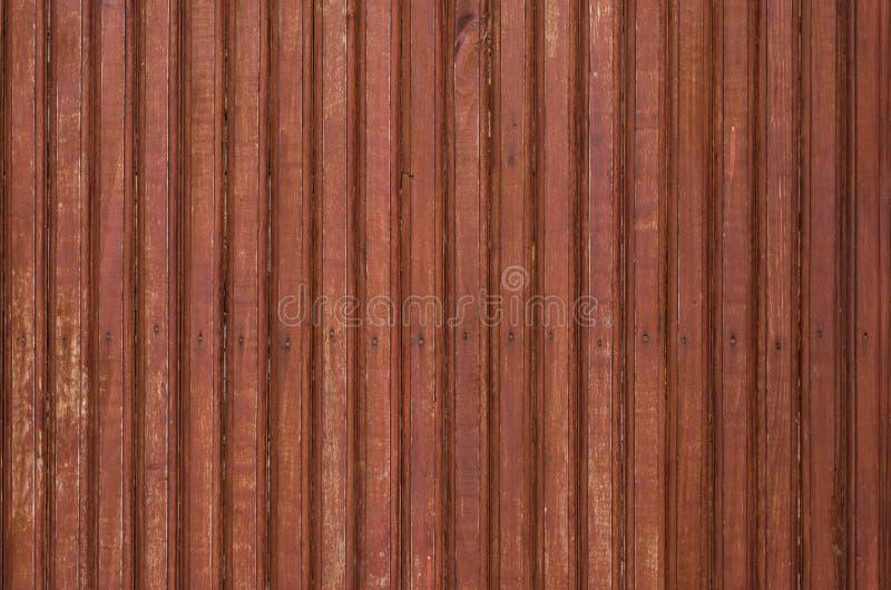 Fragment van de oude bruine gekleurde houten deur met kleine spijkers Textuur royalty-vrije stock foto