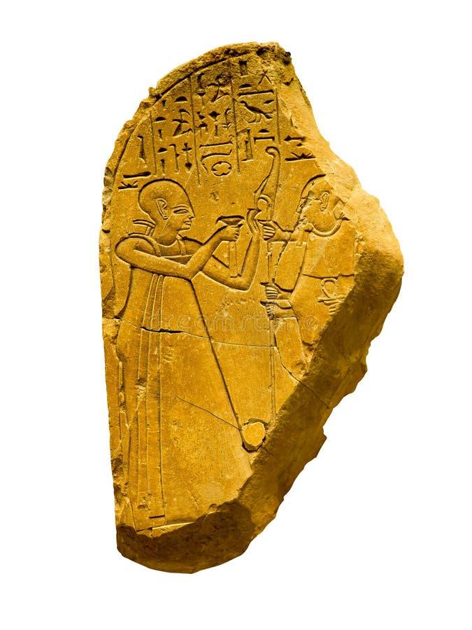 Fragment van een oude Egyptische hiëroglief met menselijke cijfers stock afbeeldingen